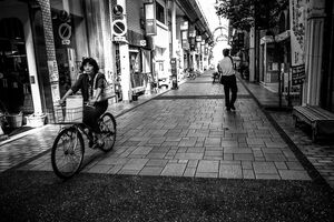 Bicycle running shopping arcade