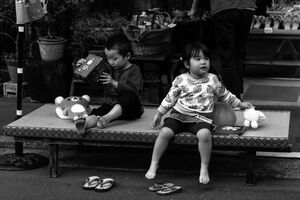 Two kids on bench