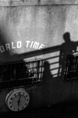 Shadows and clock on the wall