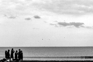 Schoolgirls gathering on Yuigahama beach