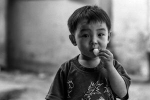 Boy looking while eating snack