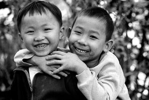 Two boys smiling happily