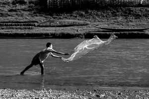 boy throwing net