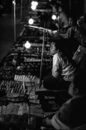 Woman working in night market