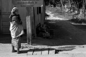 Akha woman standing in a street corner