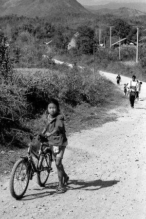 Girl walking bicycle