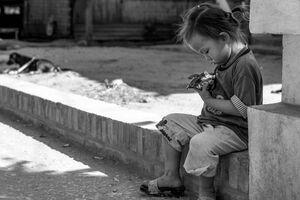 little child sitting alone