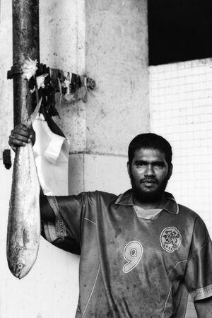 Man lifting big fish