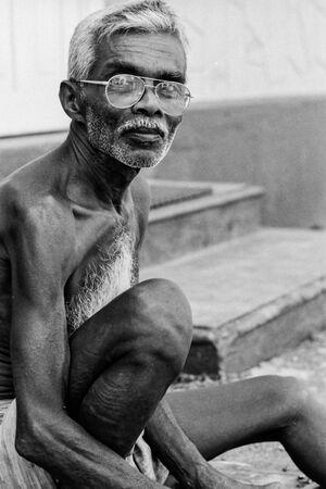 Old man working shirtless