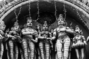 Hindu deities standing on roof of temple