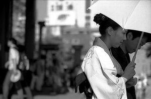 Young woman wearing Kimono coming out of Senso-ji