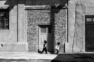 Two kids playing in old town