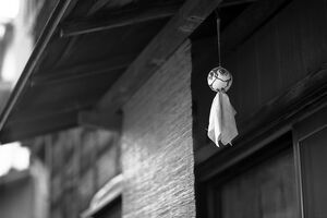 Doll hung under eaves