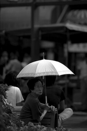 Older woman holding umbrella