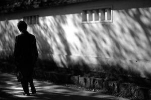 Silhouette beside wall