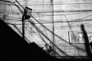 Bicycle propped against wall