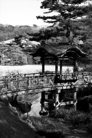 wooden bridge in Sankeien garden