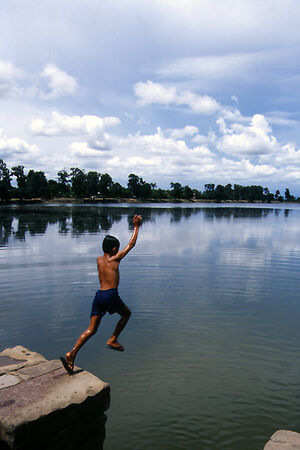 Boy jumping into Srah Srang