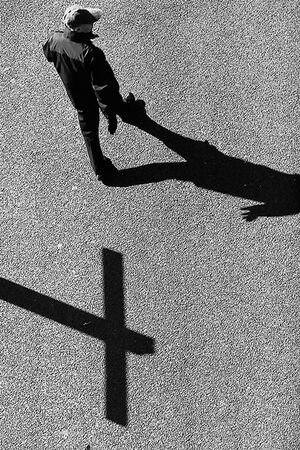Shadow of cross on ground
