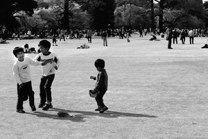 three kids playing on lawn