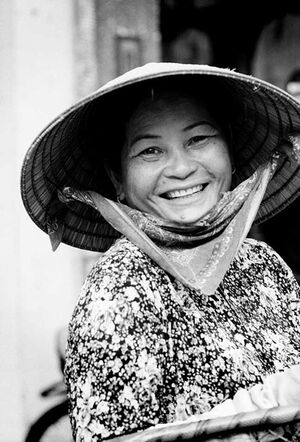 Cute woman wearing conical hat