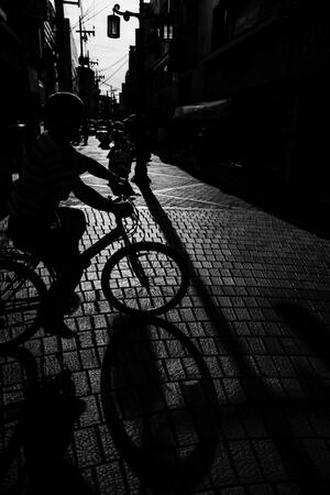 Silhouette of bicycle cutting across