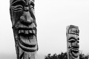 Wooden statues smiling