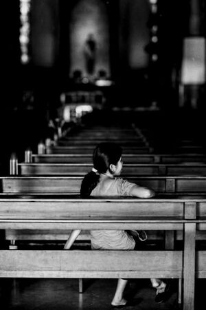 Woman relaxing in Manila Cathedral