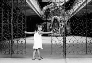 Girl standing at the gate