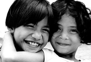 Two girls smiling happily