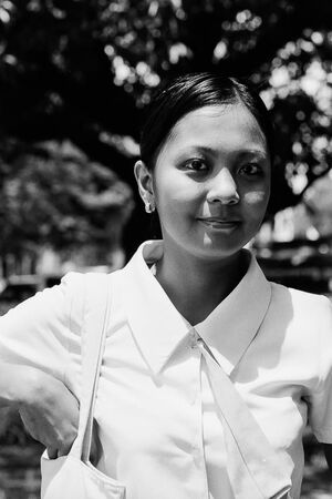 School girl wearing pure white shirt