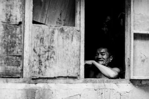 Man smiling by window