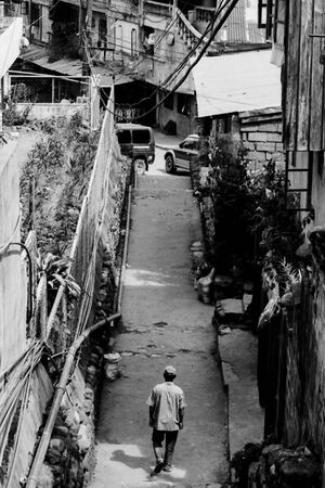 Man walking backstreet