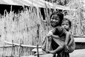 Little girl shouldering baby