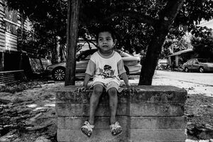 Boy sitting on the concrete blocks