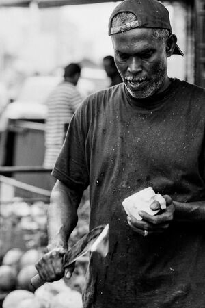 Man cutting coconut