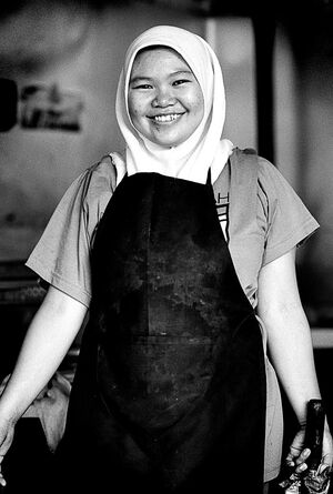 Smiling girl wearing apron