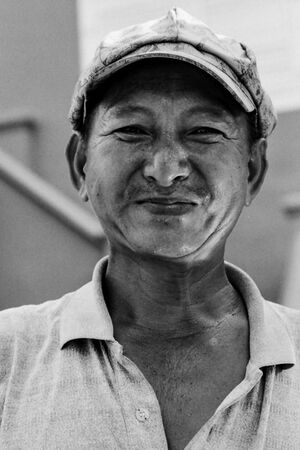 Bashful smile of street vendor