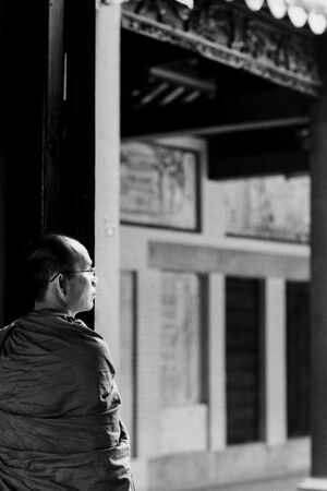 Buddhist monk standing at door