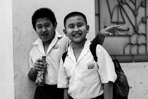 Two school boys smiling