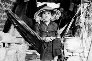 Older woman sitting on hammock