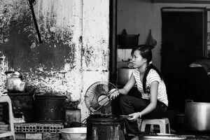 Woman roasting by roadside