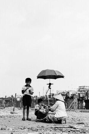 Street vendor working under umbrella