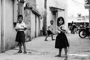 Three kids playing in lane