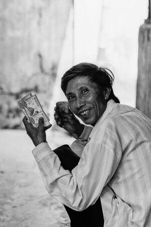 Man having lotteris in hand