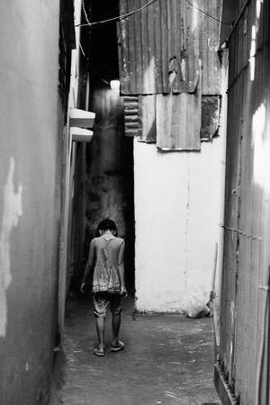 Woman walking in downcast attitude