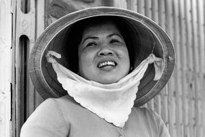 Woman wearing conical hat