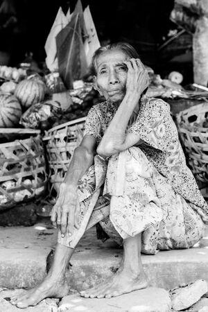 Shoeless woman sitting
