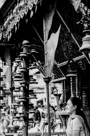 Woman smiling in front of Hindu temple