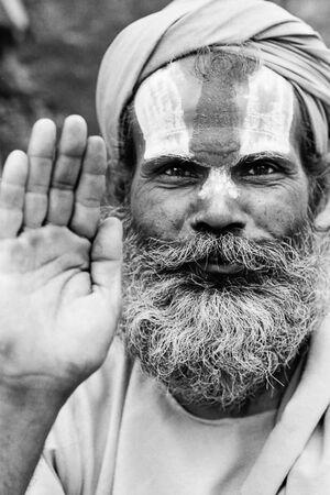 Sadhu replying with hand raise